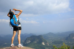 Cheering woman hiker yell at mountain peak Royalty Free Stock Images