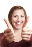 Cheering woman holding both thumbs stock image