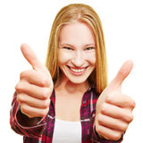Cheering woman holding both thumbs up Royalty Free Stock Image
