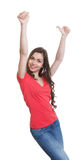 Cheering woman with long dark hair and red shirt Royalty Free Stock Photo