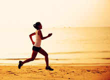 asian woman running at seaside morning Royalty Free Stock Images