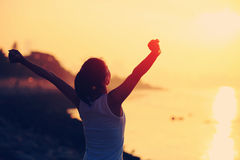 Cheering woman open arms on beach Royalty Free Stock Image