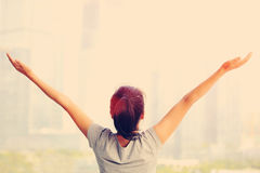 Cheering woman open arms at city Royalty Free Stock Photos