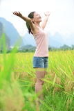 Cheering woman open arms at cole flower field Stock Images