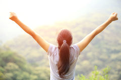 Cheering woman open arms mountain peak Stock Photos