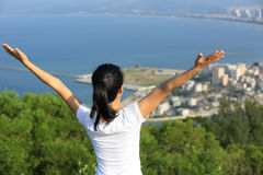 Cheering woman open arms seaside Royalty Free Stock Images