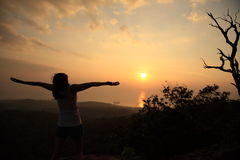 Cheering woman open arms on top hill Royalty Free Stock Photo