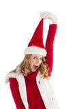 Cheering woman in santa hat Royalty Free Stock Photos