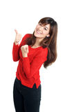 Cheering woman thumbs up in red Royalty Free Stock Photography