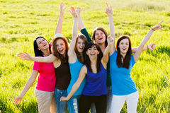 Cheering Women. Lot of happy women cheering together outdoors stock image