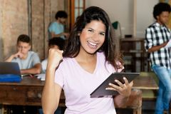Cheering woman with tablet at start up office. Cheering women with tablet and business team indoor at start up office Stock Photo