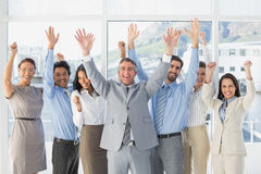 Cheering workers with raised arms Stock Photography