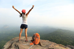 Cheering young asian woman hiker open arms Royalty Free Stock Images