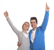 Cheering young couple looking at camera Royalty Free Stock Image
