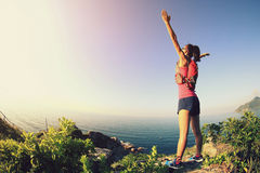 Cheering young fitness woman open arms Royalty Free Stock Images