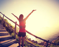 Cheering young fitness woman trail runner open arms Royalty Free Stock Photography
