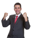 Cheering young hispanic businessman Stock Photos