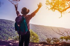 Cheering Young Male Traveler Backpacker spread out hand express Stock Images