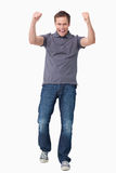 Cheering young man Stock Photo