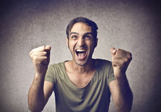 Cheering young man Stock Photography