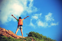 Cheering young woman backpacker enjoy the view Stock Images
