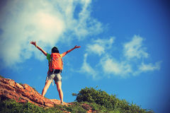 Cheering young woman backpacker enjoy the view Royalty Free Stock Photos