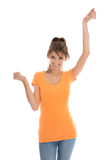 Cheering young woman with hands up in the air. Stock Photos