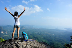 Cheering young woman hiker open arms Stock Image
