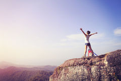 Cheering young woman hiker open arms Stock Photos
