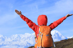 Cheering young woman hiker open arms Royalty Free Stock Photo