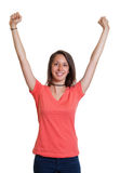 Cheering young woman in a red shirt. On an isolated white background for cut out Stock Photos