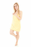 Cheering young woman in yellow towel Royalty Free Stock Images