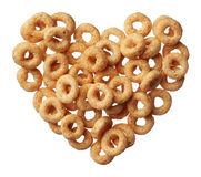 Cheerios cereal in a heart shape isolated on white Stock Photography