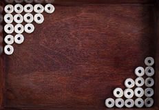 Cheerios lined as two angles into dark box. Cheerios lined as two angles into dark wood box royalty free stock photo