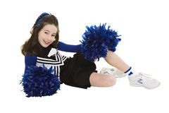 Nine year old Caucasian girl dressed in a blue cheerleader outfit  Stock Photos