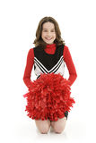 Ten year old caucasian girl dressed as a red cheerleader outfit royalty free stock images