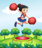 A cheerleader above a trampoline Stock Images