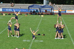 Cheerleader building pyramid Royalty Free Stock Photos