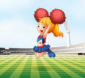 A cheerleader cheering at the field Royalty Free Stock Image