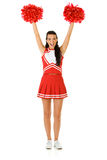 Cheerleader: Cheering with Pom Poms. Cute female as an American sports cheerleader, in red and white outfit.  Isolated on white background Stock Photos