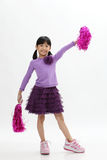 Cheerleader. Chinese girl holding pom pom Royalty Free Stock Photo