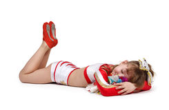 Cheerleader with color pompons sleeps Stock Photography