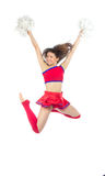Cheerleader dancer from cheerleading team jumping. In mid air and dancing isolated on a white background Royalty Free Stock Photos