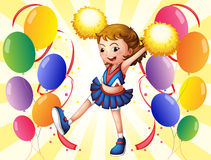 A cheerleader dancing in the middle of the balloons Royalty Free Stock Photography