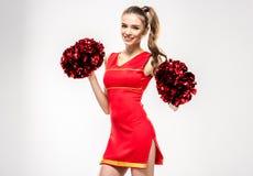 Cheerleader, die mit Pom-poms aufwirft Stockbilder