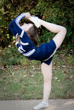 Cheerleader doing scorpion pose Royalty Free Stock Images