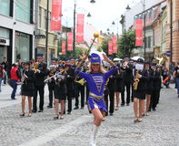 Cheerleader followed by a music band Royalty Free Stock Photo