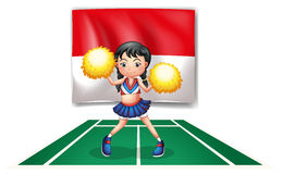 A cheerleader in front of the Indonesian Flag Royalty Free Stock Photos