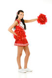 Cheerleader: Gesturing to the Side. Cute female as an American sports cheerleader, in red and white outfit.  Isolated on white background Stock Image
