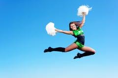 Cheerleader girl jumping Stock Image